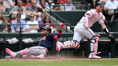 May 12, 2019; Phoenix, AZ, USA; Atlanta Braves third baseman Johan Camargo (17) slides at home to score a run in front of Arizona Diamondbacks catcher Carson Kelly (18) during the third inning at Chase Field. Mandatory Credit: Joe Camporeale-USA TODAY Sports