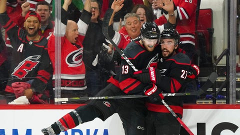 May 1, 2019; Raleigh, NC, USA; Carolina Hurricanes defenseman Justin Faulk (27) celebrates with Hurricanes left wing Warren Foegele (13) after scoring a goal in the second period against the New York Islanders in game three of the second round of the 2019 Stanley Cup Playoffs at PNC Arena. Mandatory Credit: James Guillory-USA TODAY Sports