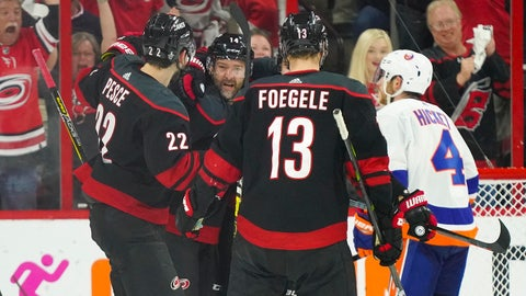 May 1, 2019; Raleigh, NC, USA; Carolina Hurricanes right wing Justin Williams (14) celebrates with teammates after scoring a goal against the New York Islanders during the third period in game three of the second round of the 2019 Stanley Cup Playoffs at PNC Arena. Mandatory Credit: James Guillory-USA TODAY Sports