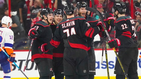 May 1, 2019; Raleigh, NC, USA; Carolina Hurricanes left wing Teuvo Teravainen (86) celebrates with teammates after scoring on an net goal during the third period against the New York Islanders in game three of the second round of the 2019 Stanley Cup Playoffs at PNC Arena. Mandatory Credit: James Guillory-USA TODAY Sports