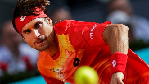 <p>               David Ferrer, from Spain, returns the ball to Roberto Bautista, from Spain, during the Madrid Open tennis tournament in Madrid, Tuesday, May 7, 2019. (AP Photo/Bernat Armangue)             </p>