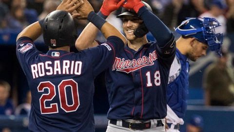 <p>               Minnesota Twins' Mitch Garver (18) high-fives teammate Eddie Rosario (20) after Garver hit a two-run home run against the Toronto Blue Jays in the sixth inning of a baseball game in Toronto, Tuesday, May 7, 2019. (Fred Thornhill/The Canadian Press via AP)             </p>