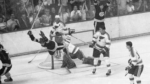 <p>               FILE - In this May 10, 1970, file photo, Boston Bruins' Bobby Orr flies through the air after scoring the winning goal past St. Louis Blues' goalie Glenn Hall during overtime in the NHL hockey Stanley Cup finals in Boston.  (AP Photo/A.E. Maloof, File)             </p>