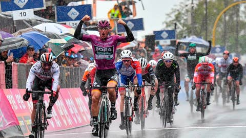 <p>               Germany's Pascal Ackermann celebrates as he sprints ahead of Colombia's Fernando Gaviria, left, to win the fifth stage of the Giro D'Italia, tour of Italy cycling race, from Frascati to Terracina, Wednesday, May 15, 2019. Pascal Ackermann of Germany sprinted to victory at the end of the rain-affected fifth stage of the Giro d'Italia as Slovenian cyclist Primoz Roglic remained overall leader. (Alessandro Di Meo/ANSA via AP)             </p>