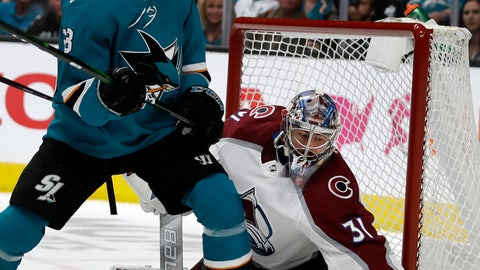 <p>               San Jose Sharks' Melker Karlsson, left, watches as Colorado Avalanche goalie Philipp Grubauer (31) gloves the puck during the first period of Game 5 of an NHL hockey second-round playoff series Saturday, May 4, 2019, in San Jose, Calif. (AP Photo/Ben Margot)             </p>