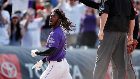 <p>               Colorado Rockies' Raimel Tapia reacts after hitting a triple to drive in three runs off Arizona Diamondbacks relief pitcher Archie Bradley in the eighth inning of a baseball game Sunday, May 5, 2019, in Denver. (AP Photo/David Zalubowski)             </p>