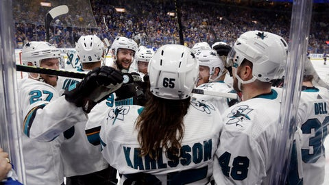 <p>               San Jose Sharks defenseman Erik Karlsson (65), of Sweden, is congratulated after scoring the winning goal against the St. Louis Blues during overtime in Game 3 of the NHL hockey Stanley Cup Western Conference final series Wednesday, May 15, 2019, in St. Louis. The Sharks won 5-4 to take a 2-1 lead in the series. (AP Photo/Jeff Roberson)             </p>