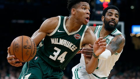 <p>               Milwaukee Bucks' Giannis Antetokounmpo (34) drives past Boston Celtics' Kyrie Irving during the first half of Game 3 of a second round NBA basketball playoff series in Boston, Friday, May 3, 2019. (AP Photo/Michael Dwyer)             </p>