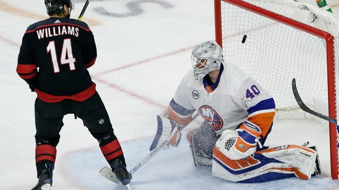 <p>               Carolina Hurricanes' Justin Williams (14) scores the game-winning goal against New York Islanders goalie Robin Lehner (40), of Sweden, during the third period of Game 3 of an NHL hockey second-round playoff series in Raleigh, N.C., Wednesday, May 1, 2019. Carolina won 5-2. (AP Photo/Gerry Broome)             </p>