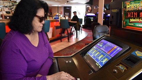 <p>               Lucille Brien plays a video poker machine at the Monte Bar and Casino in Billings, Montana, Tuesday, April 23, 2019. Montana, Iowa and Indiana are poised to be the first states to legalize sports betting this year, almost a year after the U.S. Supreme Court ended Nevada's monopoly. (AP Photo/Matthew Brown)             </p>