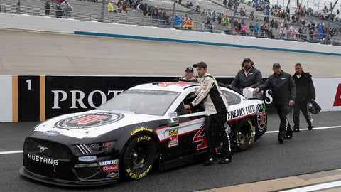 <p>               The team of Kevin Harvick pushes their race car down pit road after a NASCAR Cup series auto race was postponed due to inclement weather at Dover International Speedway in Dover, Del., Sunday, May 5, 2019. The race was rescheduled for Monday (AP Photo/Jason Minto)             </p>