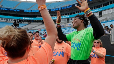 """<p>               Carolina Panthers Cam Newton, right, celebrates as participants sing """"Happy Birthday"""" during his charity kickball tournament in Charlotte, N.C., Friday, May 10, 2019. Both Panthers QBs will be action Friday. Cam Newton will be on the field at Bank of America Stadium throwing balls _ kickballs, that is _ as part of his annual Kicking it with Cam Kickball Tournament. Meanwhile rookie draft pick QB Will Grier will throwing footballs for the first time as Carolina opens rookie minicamp on the team's practice fields outside the stadium. (AP Photo/Chuck Burton)             </p>"""