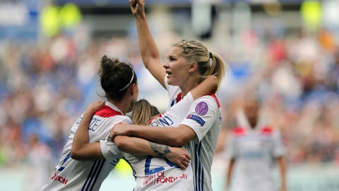 <p>               Lyon's Delphine Cascarino, center, celebrates with Ada Hegerberg, right, and Lucy Bronze, left, after scoring a goal against Chelsea during their Women's Champions League semifinal soccer match in Decines, France, Sunday, April 21, 2019. (AP Photo/Laurent Cipriani)             </p>