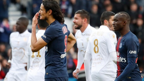 <p>               PSG's Edinson Cavani, left, reacts after missing a scoring chance during the French League One soccer match between Paris Saint-Germain and Nice at the Parc des Princes stadium in Paris, France, Saturday, May 4, 2019. (AP Photo/Christophe Ena)             </p>