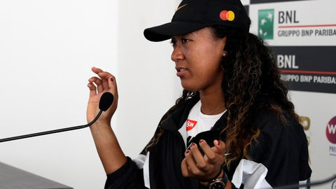 <p>               Japan's Naomi Osaka shows her hands as she meets the journalists at the Italian Open tennis tournament, in Rome, Friday, May, 17, 2019. Top-ranked Naomi Osaka withdrew from her Italian Open quarterfinal due to a right hand injury on Friday. It wasn't immediately clear how serious the injury was, or if it will affect Osaka's status for the French Open, which starts in nine days. (AP Photo/Gregorio Borgia)             </p>
