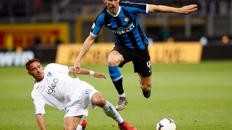 <p>               Empoli's Ismael Bennacer, left, challenges Inter Milan's Ivan Perisic during the Serie A soccer match between Inter Milan and Empoli, at the San Siro Stadium in Milan, Italy, Sunday, May 26, 2019. (AP Photo/Antonio Calanni)             </p>