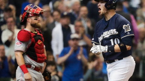 <p>               Milwaukee Brewers' Yasmani Grandal celebrates his two-run home run in front of Cincinnati Reds catcher Tucker Barnhart during the sixth inning of a baseball game Wednesday, May 22, 2019, in Milwaukee. (AP Photo/Morry Gash)             </p>