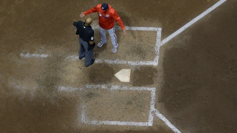 <p>               CORRECTS SPELLING TO BUCKNOR, INSTEAD OF BUCKNORN - Washington Nationals manager Dave Martinez argues with home plate umpire CB Bucknor during the seventh inning of a baseball game against the Milwaukee Brewers Tuesday, May 7, 2019, in Milwaukee. (AP Photo/Morry Gash)             </p>