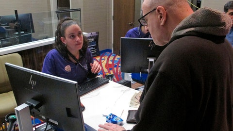 <p>               In this March 22, 2019 photo, a customer makes a sports bet at the Hard Rock casino in Atlantic City N.J. Casinos in eight states are opening or expanding retail sportsbooks to capture in-person sports betting business, even while most of the growth in the new industry is forecast to be online. (AP Photo/Wayne Parry)             </p>
