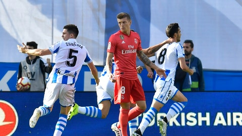 <p>               Real Sociedad's Mikel Merino, right, celebrates after scoring his side's opening goal as Real Madrid's Toni Kroos, centre, reacts during the Spanish La Liga soccer match between Real Sociedad and Real Madrid, at Anoeta stadium, in San Sebastian, northern Spain, Sunday, May 12, 2019. (AP Photo/Alvaro Barrientos)             </p>
