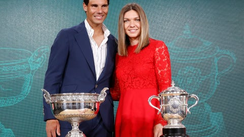 <p>               Defending champions Spain's Rafael Nadal, left, and Romania's Simona Halep pose next to the cups during the draw of the French Open tennis tournament at the Roland Garros stadium in Paris, Thursday, May 23, 2019. The French Open tennis tournament starts Sunday May 26. (AP Photo/Michel Euler)             </p>