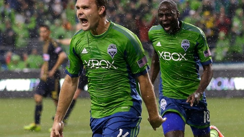<p>               FILE - In this May 3, 2014, file photo, Seattle Sounders' Chad Marshall (14) celebrates with teammate Djimi Traore after Marshall scored the game-winning goal in the second half of an MLS soccer match against the Philadelphia Union, in Seattle. Three-time MLS defender of the year Chad Marshall has announced his retirement due to injury, bringing an end to a 16-year career that included stints with the Columbus Crew and Seattle Sounders. Marshall announced his decision Wednesday, May 22, 2019, after missing Seattle's last two games with knee inflammation. (AP Photo/Ted S. Warren, File)             </p>