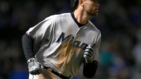 <p>               Miami Marlins' Jon Berti watches his solo home run during the sixth inning of a baseball game against the Chicago Cubs, Monday, May 6, 2019, in Chicago. (AP Photo/Paul Beaty)             </p>
