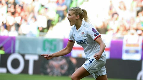 <p>               Ada Hegerberg of Lyon celebrates after scoring a goal during the women's soccer UEFA Champions League final match between Olympique Lyon and FC Barcelona at the Groupama Arena in Budapest, Hungary, Saturday, May 18, 2019. (Tibor Illyes/MTI via AP)             </p>