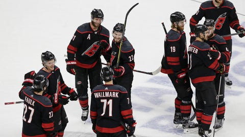 <p>               Carolina Hurricanes players celebrate following their win over the New York Islanders in Game 4 of an NHL hockey second-round playoff series in Raleigh, N.C., Friday, May 3, 2019. (AP Photo/Gerry Broome)             </p>