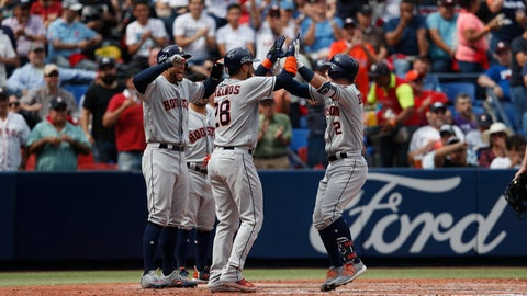 <p>               Teammates celebrate a grand slam by Houston Astros' Alex Bregman, right, in the fifth inning of a baseball game against the Los Angeles Angels, in Monterrey, Mexico, Sunday, May 5, 2019. (AP Photo/Rebecca Blackwell)             </p>