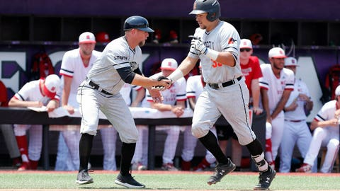 <p>               Campbell's Koby Collins (35) is congratulated by head coach Justin Haire after hitting a three-run home run in the first inning against North Carolina State at the NCAA college baseball regional tournament, Friday, May 31, 2019,  in Greenville, N.C. (Ethan Hyman/The News & Observer via AP)             </p>