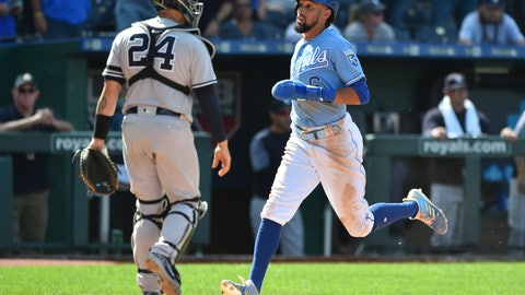 <p>               Kansas City Royals' Billy Hamilton crosses home past New York Yankees catcher Gary Sanchez to score the game-winning run on a Whit Merrifield single in the 10th inning during a baseball game Sunday, May 26, 2019, in Kansas City, Mo. The Royals won 8-7. (AP Photo/Ed Zurga)             </p>