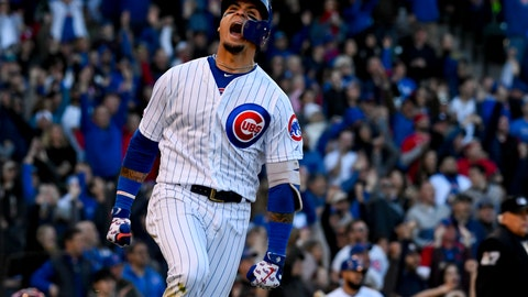 <p>               Chicago Cubs' Javier Baez reacts after hitting a home run during the eighth inning of the team's baseball game against the St. Louis Cardinals on Saturday, May 4, 2019, in Chicago. (AP Photo/Matt Marton)             </p>