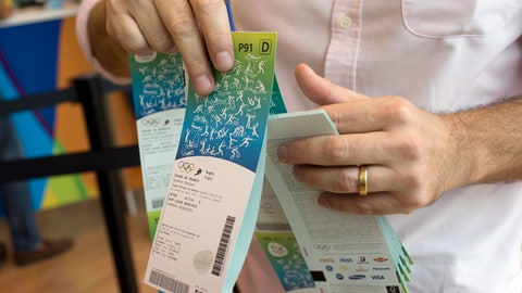 <p>               FILE - In this June 20, 2016, file photo, a man handles the Olympic tickets he just purchased at a shopping mall in Rio de Janeiro, Brazil. Tokyo Olympic organizers say millions of Japan residents have shown interest in buying tickets for next year's games. Organizers closed the first phase of ticket applications on Wednesday, May 29, 2019, for Japan residents, and applicants will be told on June 20 what tickets they have been allocated through a lottery system.(AP Photo/Silvia Izquierdo, File)             </p>