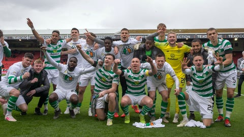 <p>               Celtic players celebrate after the final whistle of their Scottish Premiership soccer match against Aberdeen at Pittodrie Stadium, Aberdeen, Scotland, Saturday, May 4, 2019. Celtic won the Scottish league title for the eighth straight year on Saturday, completing the second leg in its bid to clinch a domestic treble for the third straight season. A 3-0 win at Aberdeen moved Celtic into an unassailable 12-point lead in the Scottish Premiership. (Jeff Holmes/PA via AP)             </p>