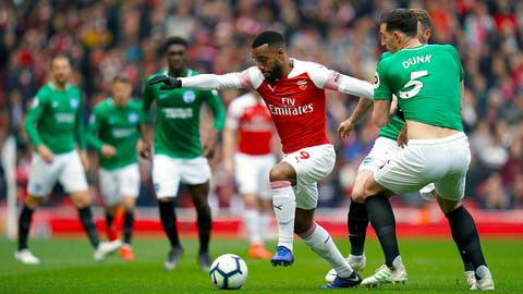 <p>               Arsenal's Alexandre Lacazette, left, and Brighton & Hove Albion's Lewis Dunk battle for the ball during the English Premier League soccer match at the Emirates Stadium, London, Sunday May 5, 2019. (John Walton/PA via AP)             </p>