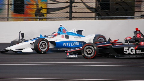 <p>               Will Power, of Australia, right, avoids the car driven by Felix Rosenqvist, of Sweden, after Rosenqvist hit the wall in the second turn during practice for the Indianapolis 500 IndyCar auto race at Indianapolis Motor Speedway, Wednesday, May 15, 2019 in Indianapolis. (AP Photo/Mike Fair)             </p>