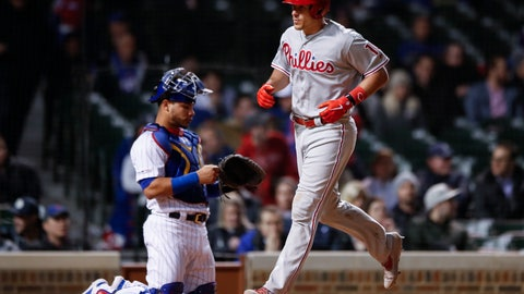 <p>               Philadelphia Phillies' J.T. Realmuto, right, crosses home plate after hitting a solo home run against the Chicago Cubs during the 10th inning of a baseball game, Monday, May 20, 2019, in Chicago. (AP Photo/Kamil Krzaczynski)             </p>