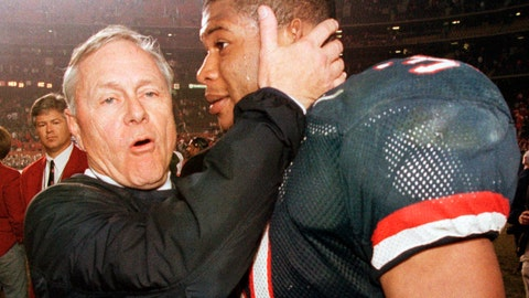 <p>               FILE - In this Dec. 30, 1998, file photo, Arizona coach Dick Tomey, left, congratulates linebacker DaShon Polk after the Wildcats 23-20 win over Nebraska in the Holiday Bowl NCAA college football game in San Diego. Tomey, the winningest football coach in University of Arizona history, died Friday night, May 10, 2019, in Tucson, Ariz. He was 80. Tomey was 183-145-7 overall in 20 years as head coach at Hawaii, Arizona and San Jose State. He was diagnosed with lung cancer in December.  (AP Photo/Denis Poroy, File)             </p>