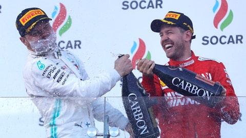 <p>               Mercedes driver Valtteri Bottas of Finland, left, celebrates with third placed Ferrari driver Sebastian Vettel of Germany after winning the Formula One Grand Prix at the Baku Formula One city circuit in Baku, Azerbaijan, Sunday, April 28, 2019. (AP Photo/Sergei Grits)             </p>