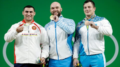 <p>               File - In this Monday, Aug. 15, 2016 file photo, Ruslan Nurudinov, of Uzbekistan, center, holds his gold medal as he is joined by silver medalist Simon Martirosyan, of Armenia, left, and bronze medalist Alexandr Zaichikov, of Kazakhstan, right, during the medal ceremony for the men's 105 kg weightlifting event at the 2016 Summer Olympics in Rio de Janeiro, Brazil. Nurudinov has been disqualified from the 2012 London Games for doping with an anabolic steroid. The Court of Arbitration for Sport says its new anti-doping chamber stripped Nurudinov of fourth place in London in the 105-kilogram weight class. The 27-year-old lifter from Uzbekistan now faces a ban from the International Weightlifting Federation. (AP Photo/Mike Groll, File)             </p>