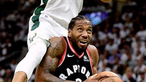 <p>               Toronto Raptors forward Kawhi Leonard (2) is fouled by Milwaukee Bucks forward Giannis Antetokounmpo (34) during the second half in Game 1 of the NBA basketball playoffs Eastern Conference final in Milwaukee on Wednesday, May 15, 2019. (Frank Gunn/The Canadian Press via AP)             </p>