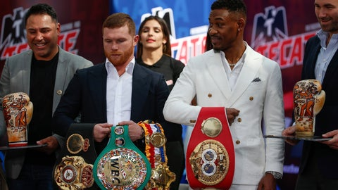 <p>               FILE - In this March 1, 2019, file photo, WBC and WBA middleweight world champion Canelo Alvarez, second from left, and IBF middleweight world champion Daniel Jacobs, second from right,  pose with their title belts during a press conference in Mexico City. The moment won't be too big for Daniel Jacobs, of that he's certain. Not after going toe-to-toe with the fearsome Gennady Golovkin before dropping a narrow decision. Not after beating cancer that doctors were sure would end his career, if not his life. Canelo Alvarez will just be another obstacle in front of him when they meet Saturday night, May 4 in a middleweight title unification fight. (AP Photo/Anthony Vazquez, Fikle)             </p>
