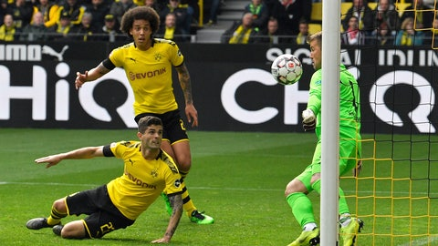 <p>               Dortmund's Christian Pulisic, on the ground, scores the opening goal past Duesseldorf goalkeeper Michael Rensing, right, during the German Bundesliga soccer match between Borussia Dortmund and Fortuna Duesseldorf in Dortmund, Germany, Saturday, May 11, 2019. (AP Photo/Martin Meissner)             </p>