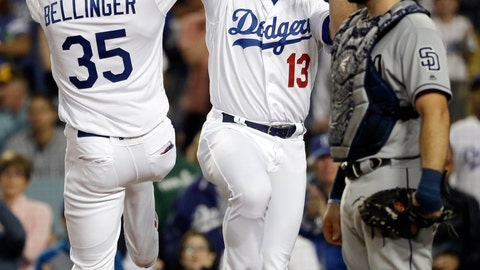 <p>               Los Angeles Dodgers' Cody Bellinger (35) celebrates his two-run home run at home plate with teammate Max Muncy (13) next to San Diego Padres catcher Austin Hedges during the third inning of a baseball game Tuesday, May 14, 2019, in Los Angeles. (AP Photo/Marcio Jose Sanchez)             </p>