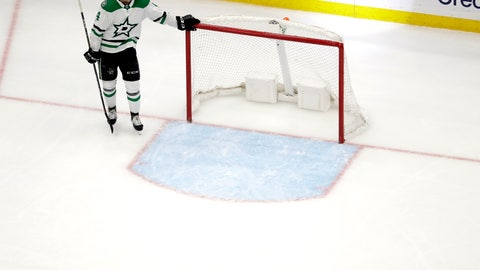 <p>               Dallas Stars' Miro Heiskanen, of Finland, stands at the net as the St. Louis Blues celebrate after Pat Maroon scored during the second overtime in Game 7 of an NHL second-round hockey playoff series Tuesday, May 7, 2019, in St. Louis. The Blues won 2-1, taking the series. (AP Photo/Jeff Roberson)             </p>