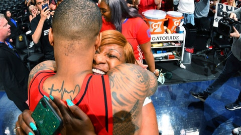 <p>               Portland Trail Blazers guard Damian Lillard is hugged by his mother, Gina Johnson, after the second half of Game 7 of an NBA basketball second-round playoff series Sunday, May 12, 2019, in Denver. The Trail Blazers won 100-96. (AP Photo/David Zalubowski)             </p>
