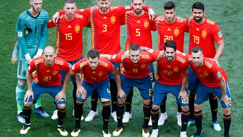 <p>               FILE - In this Sunday, July 1, 2018 file photo, players of the team of Spain line up for a team photo prior to the round of 16 match between Spain and Russia at the 2018 soccer World Cup at the Luzhniki Stadium in Moscow, Russia. The Spanish soccer federation said Monday May 20, 2019 it was ending its contract with Adidas and opened negotiations with other apparel companies. (AP Photo/Vincent Michel, File)             </p>