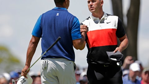 <p>               Brooks Koepka, right, shakes hands with Tiger Woods after finishing the first round of the PGA Championship golf tournament, Thursday, May 16, 2019, at Bethpage Black in Farmingdale, N.Y. (AP Photo/Julio Cortez)             </p>