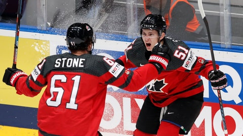 <p>               Canada's Mark Stone celebrates with Troy Stecher, right, after scoring his side's first goal during the Ice Hockey World Championships semifinal match between Canada and Czech Republic at the Ondrej Nepela Arena in Bratislava, Slovakia, Saturday, May 25, 2019. (AP Photo/Petr David Josek)             </p>